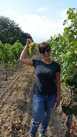 Chrystal Clifton standing in the vineyard