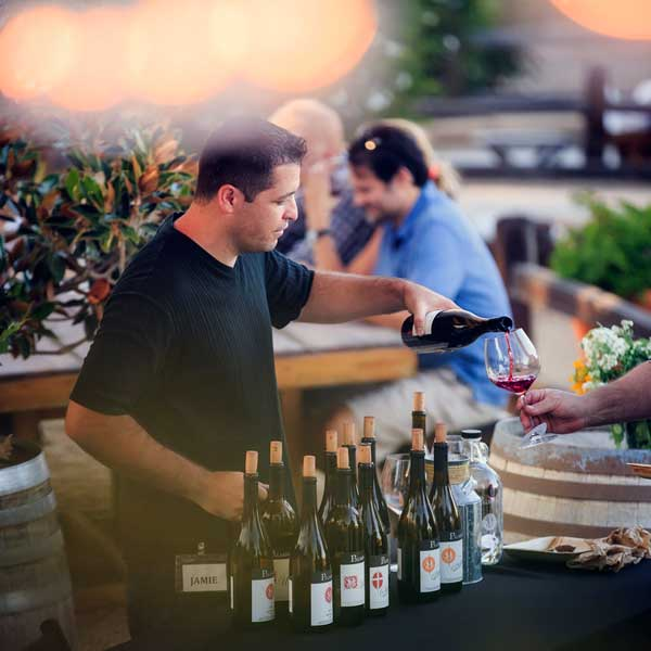 Pouring Wine at a Palmina Wines Club Party